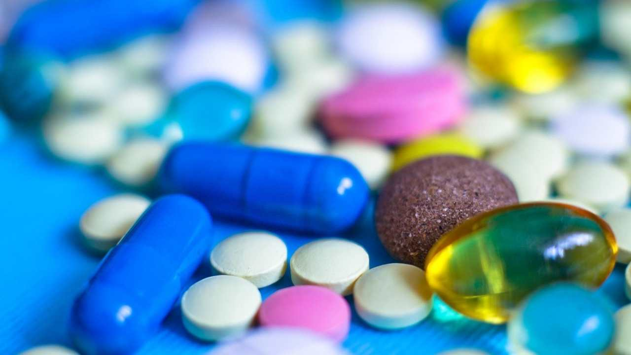 various medications on a blue surface